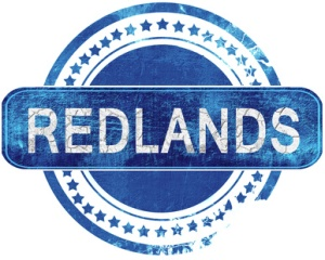 redlands grunge blue stamp. Isolated on white.